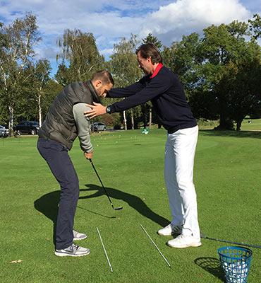 Golftrainer Olaf Strunck mit Schüler